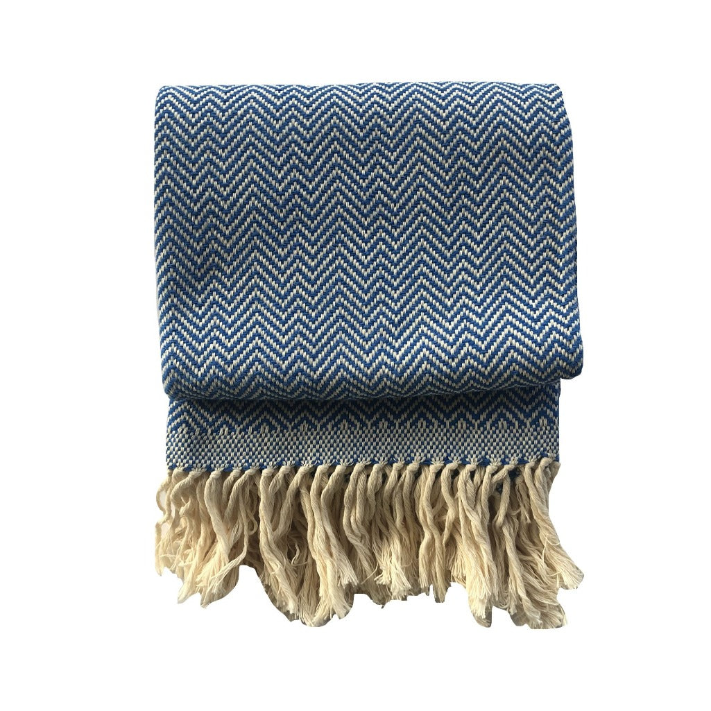 Handmade cotton herringbone throw and blanket handmade by Living Threads Co. artisans in Nicaragua in Royal Blue