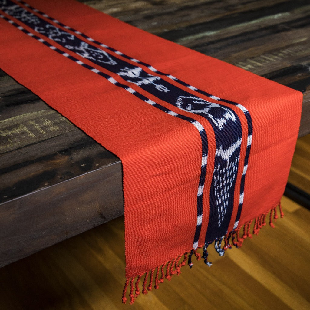 TAY Ikat Natural Dye table runner hand woven in Guatemala on Mayan backstrap loom by Living Threads Co. skilled artisans in bright orange Achiote
