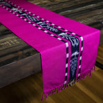 Handwoven naturally dyed TAY Ikat table runner in Pink made by Guatemalan partner artisans on a traditional Mayan backstrap loom.