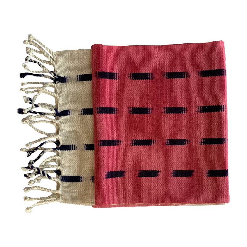 Handcrafted dip dye throw by Living Threads Co. artisans in Guatemala in pink