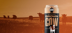 Calabogie Brown Cow Stout with countryside site field with cows in background