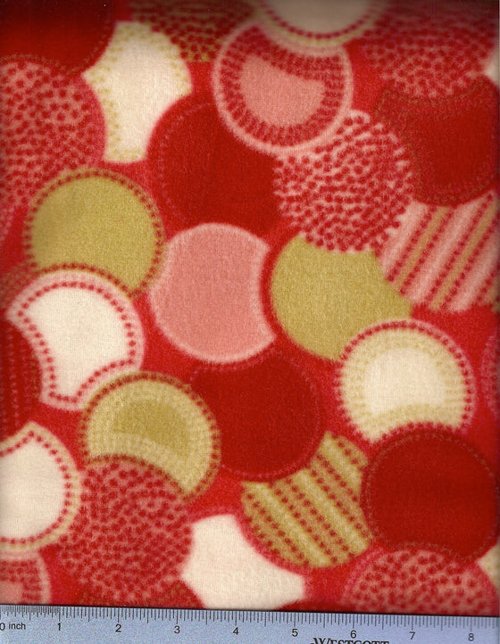 Red fleece with dots in green, white and shades of red; replacement dog bed cover.