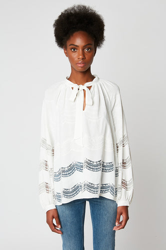 Loose blouse with embroidery