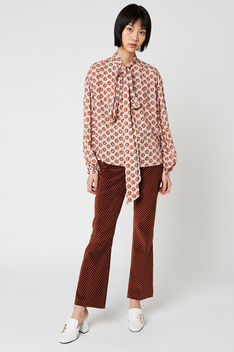 Loose printed blouse with knotted collar