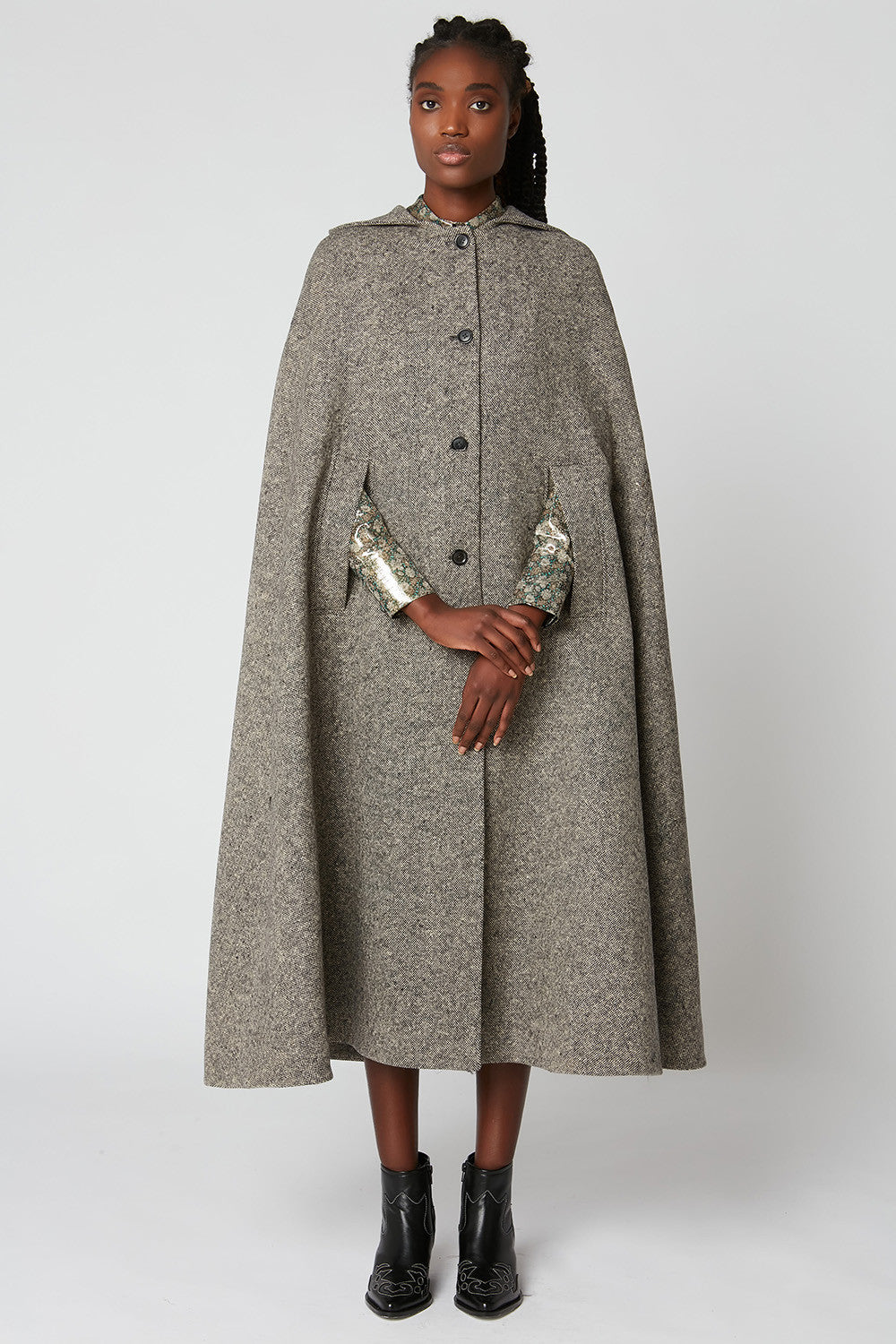 Long tweed hooded cape with button fastening