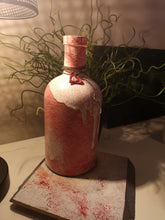 Load image into Gallery viewer, Red and white painted rum bottle candle holder