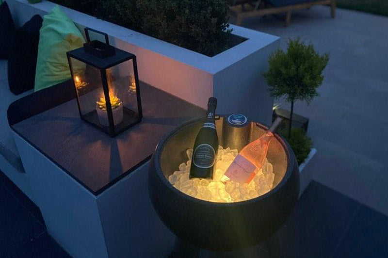 outdoor drinks cooler containing ice and LED lights