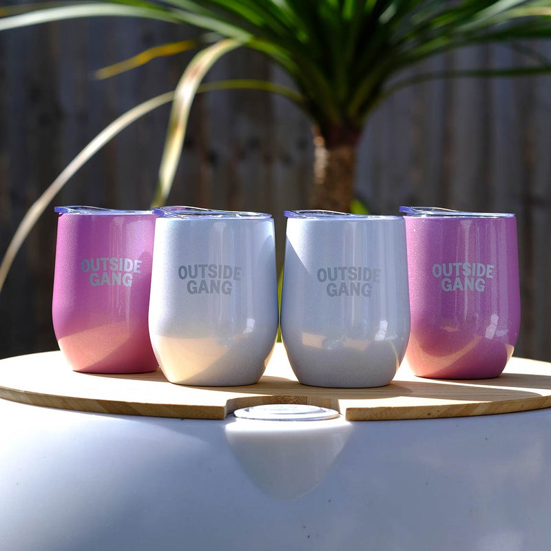 4 stainless steel cups standing on our drinks cooler for garden