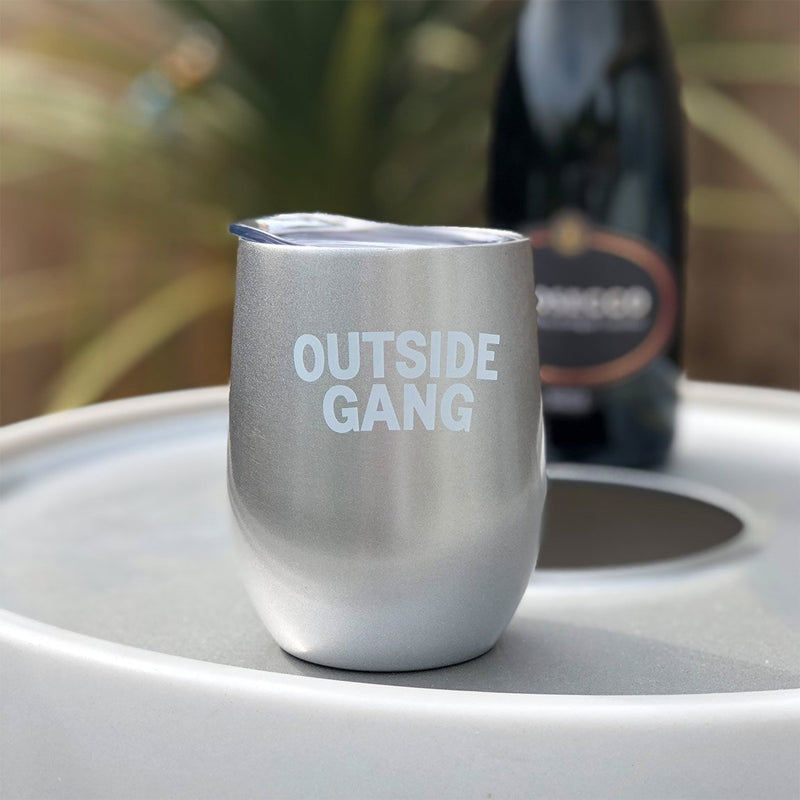 silver stainless steel cup with lid, sitting on our drinks cooler for garden