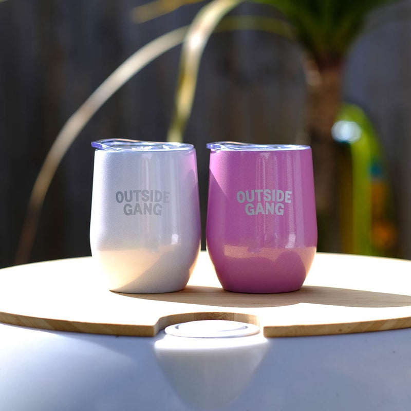 2 tumblers white and pink sitting on one of our garden drinks coolers