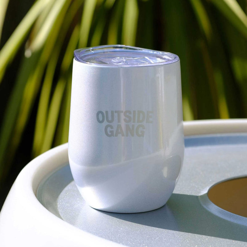white stainless steel cup sitting on our drinks cooler for garden
