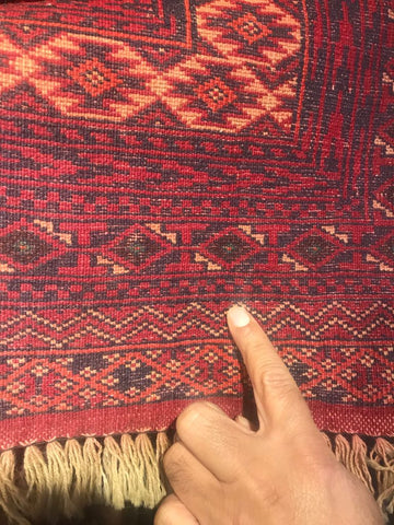 Handmade carpet back of the carpet red and yellow colours