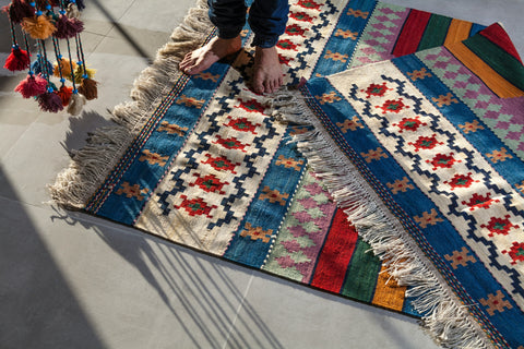 Two handmade kilims bule, red and white with two feet