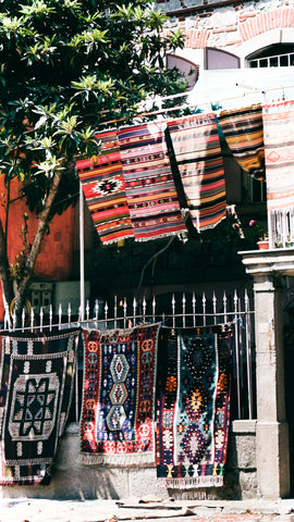 colourful handmade carpets hung on a few rows on the street