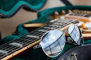 Fender guitar. Ray ban sunglasses