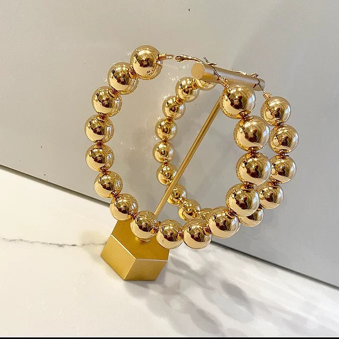 Oversized gold ball hoops