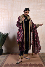 Load image into Gallery viewer, A straight kali kurta in ink blue and purple velvet paired with a choti mori velvet salwar and a floral dupatta