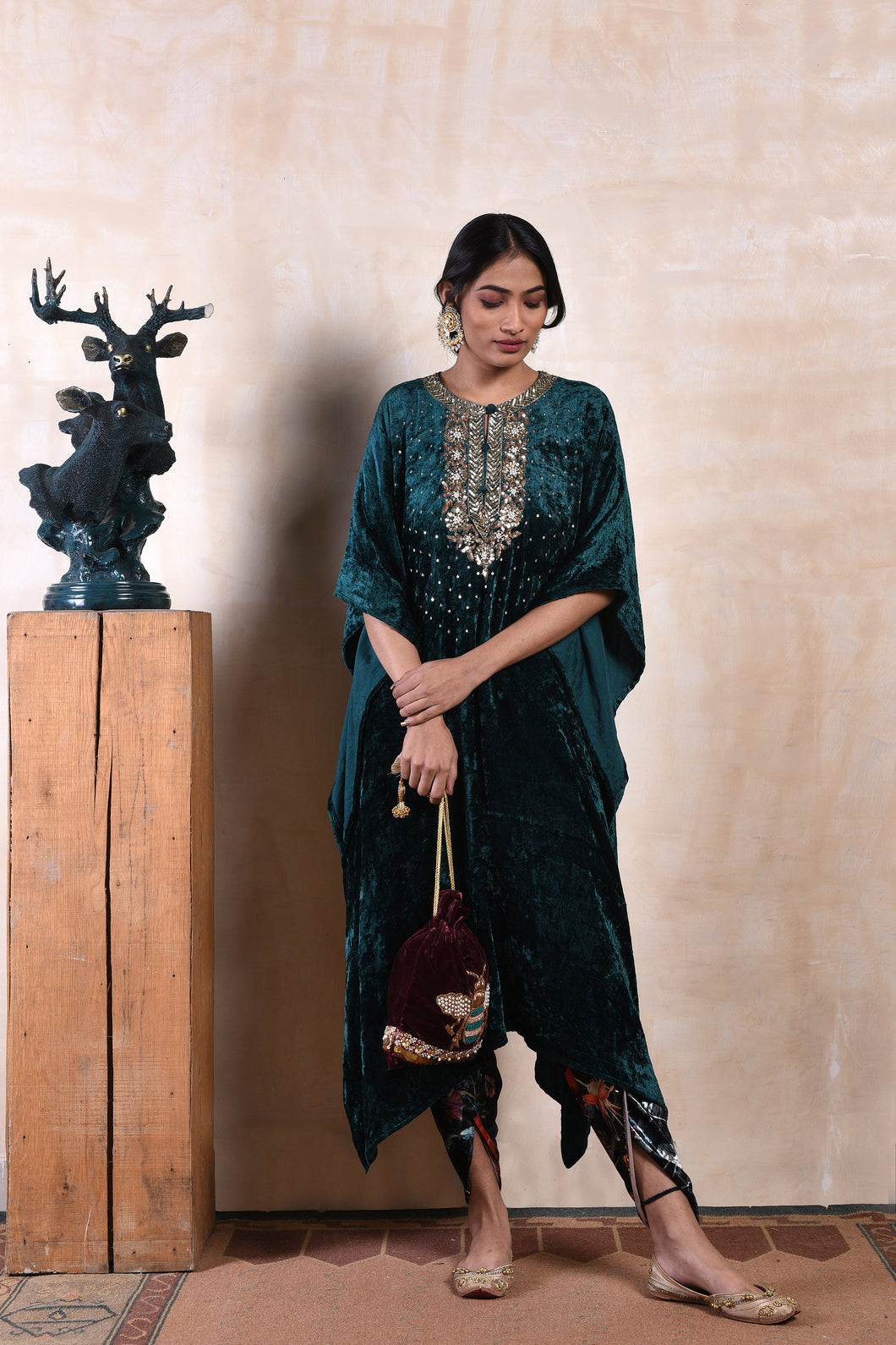 sequinned emerald short cape with floral shaneel tulip pants. best adorned with embellished juttis
