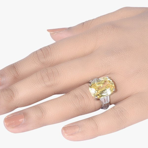 RADIANT CUT YELLOW SAPPHIRE WITH BAGUETTES ON EITHER SIDE