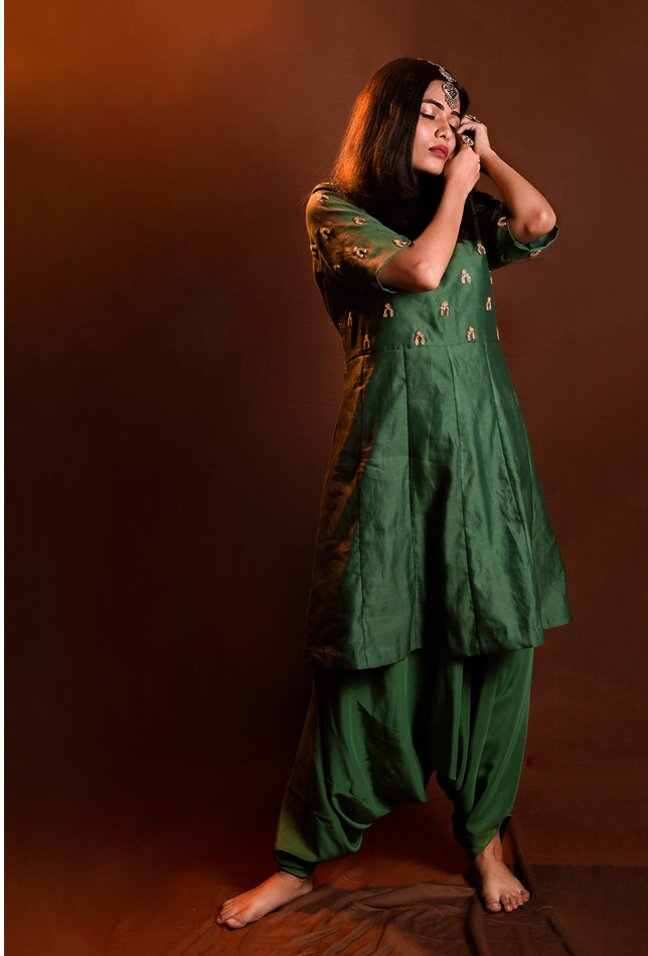 KALI KURTA WORK ON BOTH FRONT AND BACK YOKE, PAIRED WITH DHOTI PANTS.