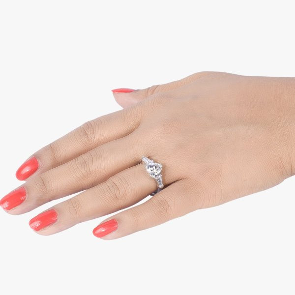 HEART SHAPED SOLITAIRE WITH BAGUETTES ON EITHER SIDE