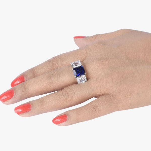 BLUE SAPPHIRE CENTER WITH EMERALD CUT DIAMONDS ON EITHER SIDE