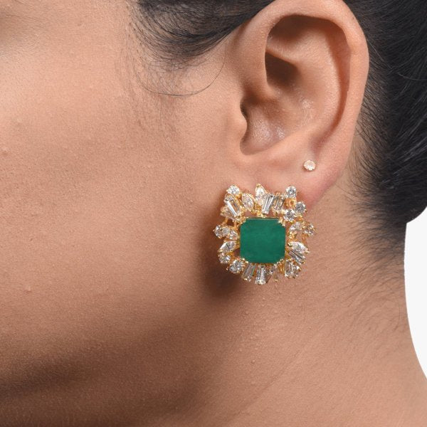 EMERALD STUD WITH ASYMMETRICAL BAGUETTE DIAMONDS HALO IN 18K GOLD POLISH