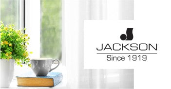 George N Jackson Fabrics logo and image of plant, book, and tea cup in front of window