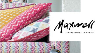Maxwell Fabrics logo and image of pink pillows with patterns