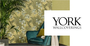 york wallcoverings logo and room with green chair and plant
