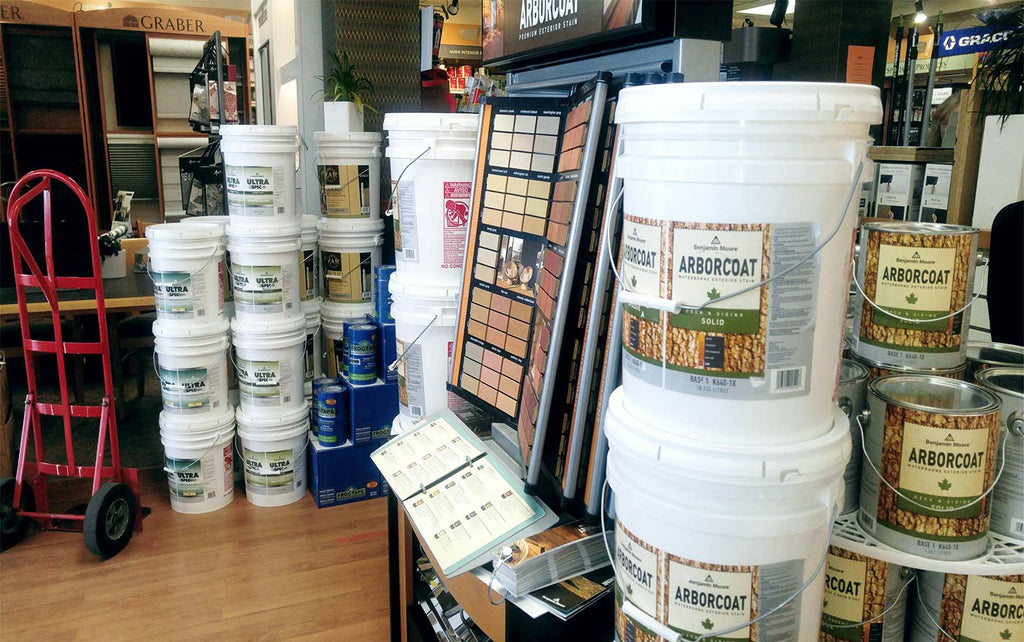 buckets and paint cans stacked in paint store