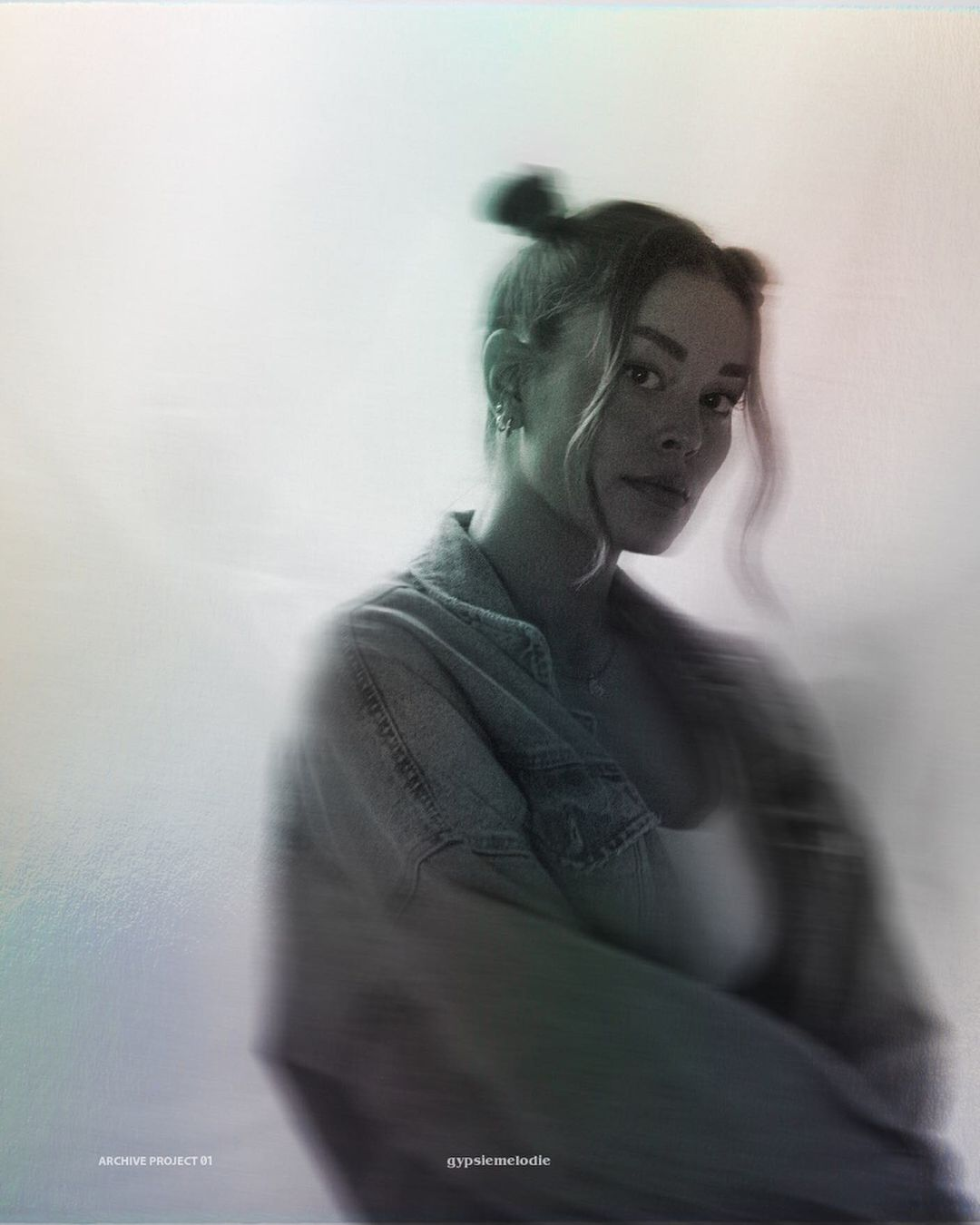black and white blurry image of girl taken on a film camera