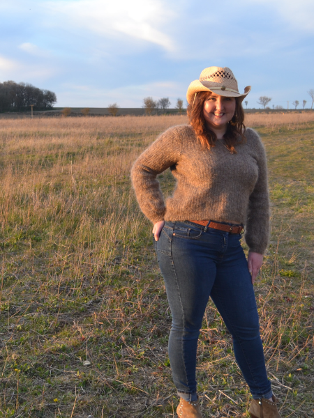 Cowboy hat and jumper with sunset