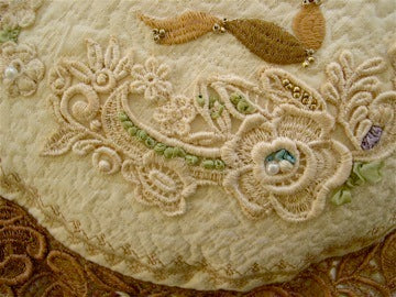 pillow-with-antique-dyed-lace-fabric-trim.jpg