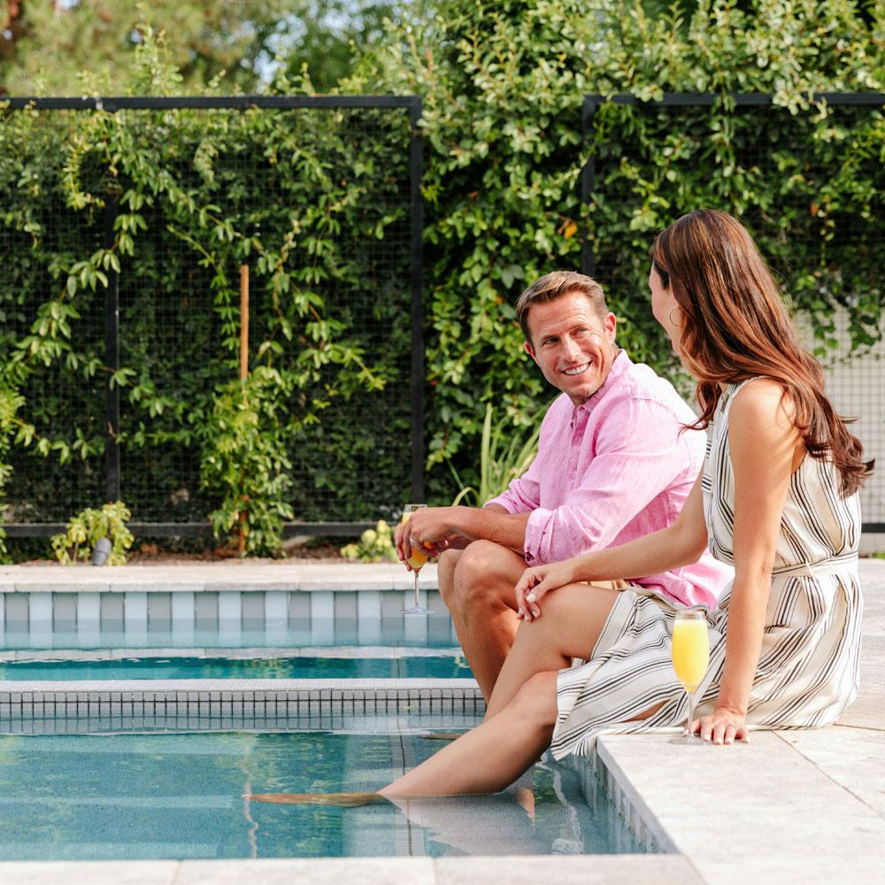 Champagne Flute Enjoyed by Couple by the Pool