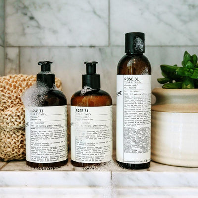 Le Labo products displayed on the shower ledge