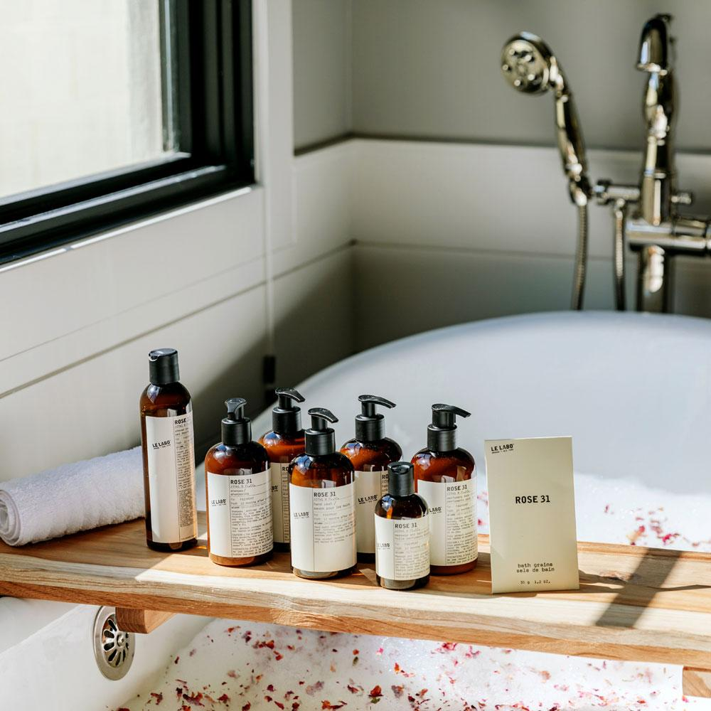 Le Labo Rose 31 collection on tray in bath tub