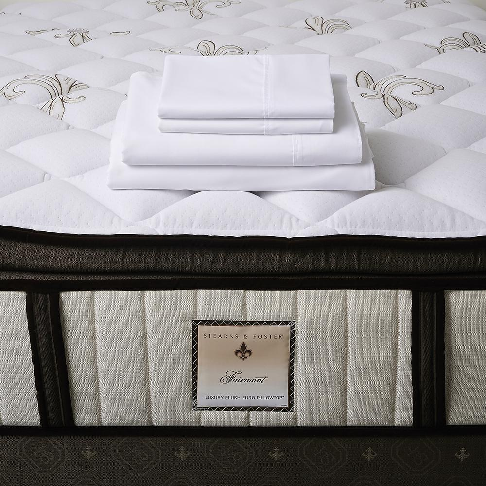 The Fairmont Signature Bed - Sealy Sterns & Foster mattress and folded bed sheets