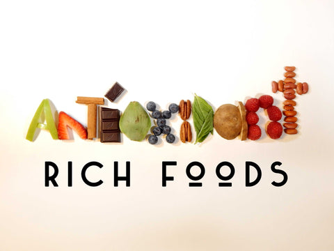 A variety of antioxidant rich foods spelling the word antioxidant.