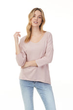 Light blush sparkling knit shirt with scoop neck and long sleeves on woman, Pazazz Shelburne