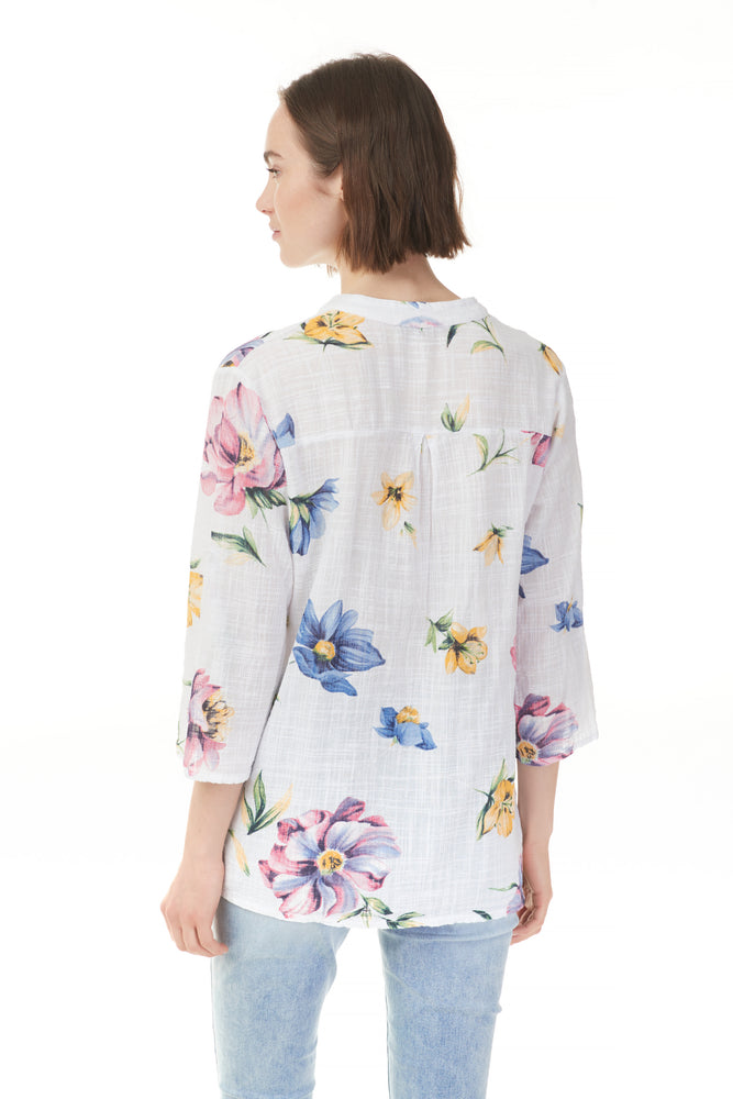 White floral popover blouse with pink, blue, and yellow flowers, ladies clothing stores online