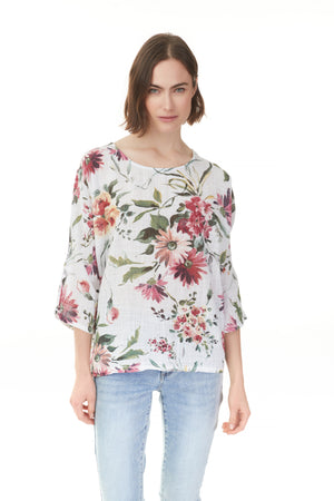 Woman wearing fiesta floral print top with quarter sleeves, ladies wear Pazazz