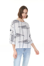 woman in white quarter sleeve top with black fish print, shop ladies clothes Pazazz