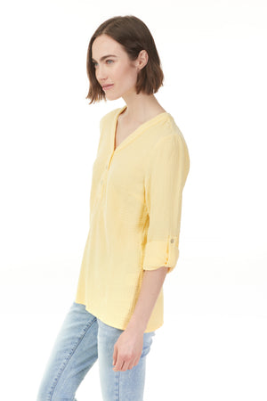 Side view of cuffed yellow cotton blouse shop Pazazz clothing now!