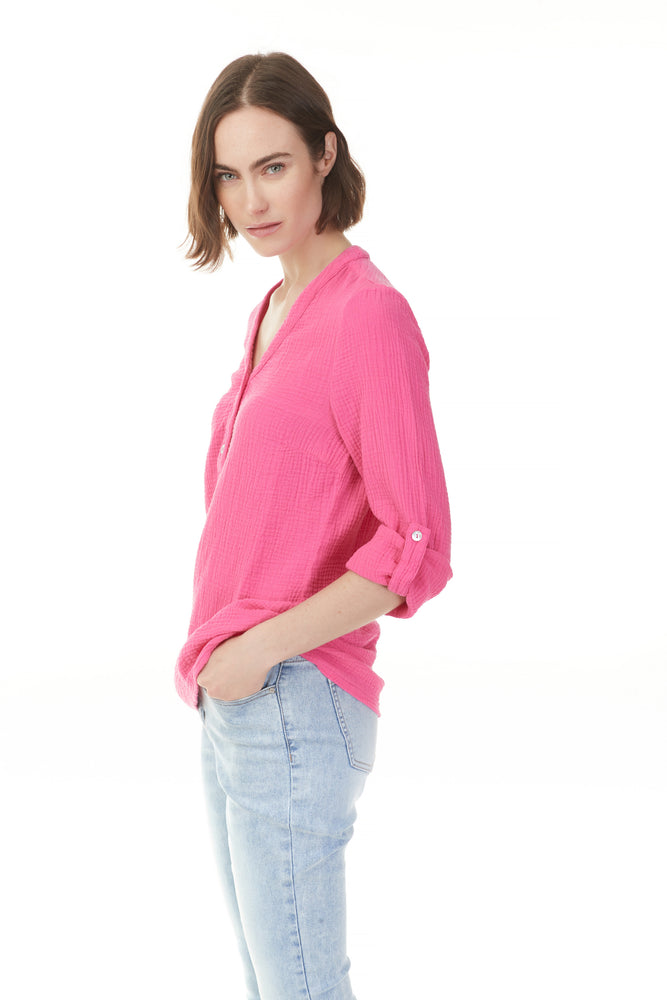 Side view of woman in pink cotton blouse with cuffed sleeves from Pazazz, shop ladies clothes