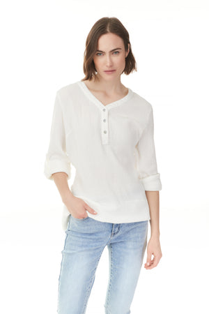 White solid cotton popover blouse on woman with cuffed sleeves, shop ladies clothes Shelburne