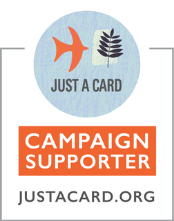 Just a card logo with an orange bird and leaf on a light blue background, also reads 'campaign supporter - JustACard.org'