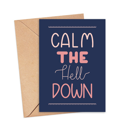 Greetings card featuring hand lettered text that reads 'calm the hell down' in shades of pink on a navy blue background, by Lulibell Studio.
