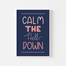 Load image into Gallery viewer, A photograph of our 'Calm The Hell Down' print on a white wall in a white frame - hand lettered text that reads 'calm the hell down' in shades of pink on a navy blue background.