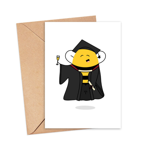 Greetings card featuring an illustration of a bee in a cap and gown holding a glass of champagne and a scroll tied with a bow, by Lulibell Studio.